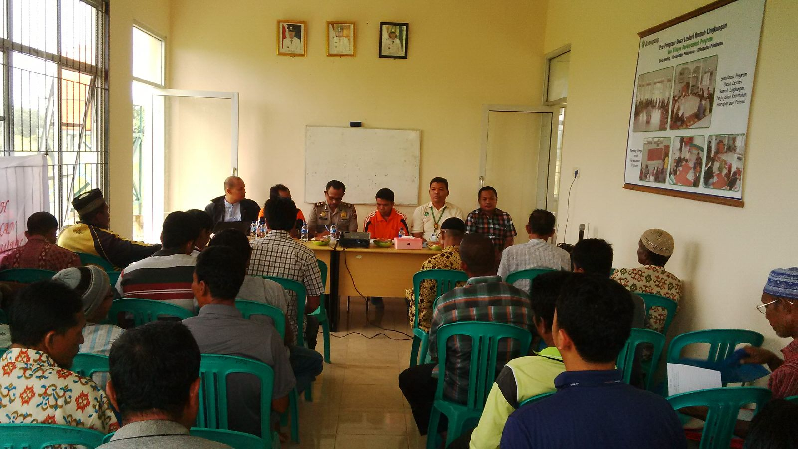 APRIL team discussing the Fire Free Village Program with the communities.