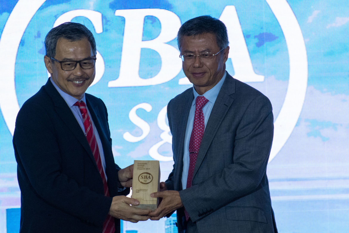 Mr. Bey Soo Khiang, Chairman, APRIL Group (right), receiving one of APRIL's awards at the Sustainable Business Awards in Singapore.